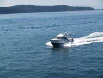 Cabin Motor Boat Underway. Motor Boat under speed on bay Stock Photo