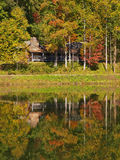 Cabin on mountain lake Stock Image