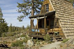 Cabin in the mountains. A-frame cabin in the Sierra Nevada Range Stock Photo