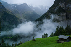 Cabin in mountains. Alpine cabin in Gimmelwald Switzerland on a stormy day Stock Image