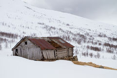 Cabin in mountains. Aurland, Norway snow road Stock Photos