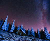 Cabin in the mountains. Fantastic winter meteor rain and snowy . Carpathian Ukraine Europe Stock Photography