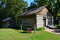 A cabin at New Salem, Illinois. A pioneer cabin with wheelbarrow and outhouse at Abraham Lincoln's New Salem State Historical site in Illinois Stock Images