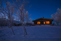 A cabin at night Royalty Free Stock Photography