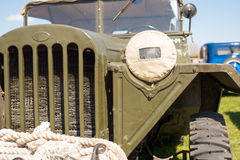 Cabin of old military truck with camouflaged headlight. Stock Image
