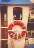 Lifebuoy on a yacht. The cabin of the old yacht and the rare lifebuoy Stock Photography