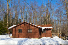 Cabin in the park covered in snow. Royalty Free Stock Photos