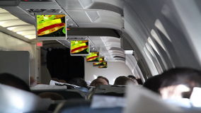 In the Cabin of Passenger Aircraft. Showing films and commercials during the flight on board the aircraft stock video