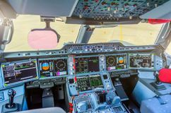 Cabin pilots aircraft view of the windshield, steering wheels, control devices. Cabin pilots aircraft view of the windshield, steering wheels, control devices Stock Image