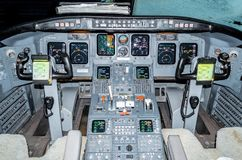 Cabin pilots aircraft view of the windshield, steering wheels, control devices. Cabin pilots aircraft view of the windshield, steering wheels, control devices Stock Photos