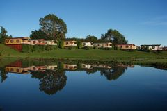 Cabin relected lake. Cabins reflected in lake deloraine Royalty Free Stock Images