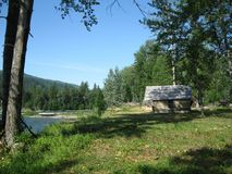 Cabin on the river bank. A re-constructed cabin or original looks royalty free stock photography