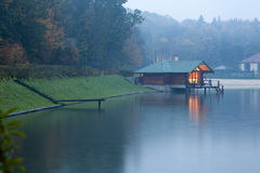 Cabin at the river bank Stock Photography