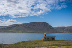 Cabin on the road near Isafjordur, Western Fjords of Iceland Stock Photos