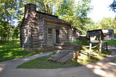 Cabin with root cellar and well Stock Photos