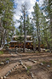 Cabin in scenic forest Stock Image
