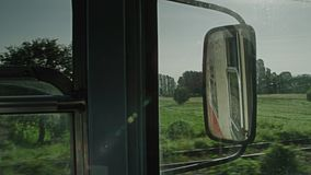 A train passing through some woods. A cabin shot of a trainride stock footage