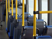 Cabin of a shuttle bus. Passenger cabin of a city shuttle bus without passengers Royalty Free Stock Image