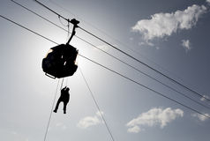 Cabin ski lift silhouette and rescuer Stock Photo