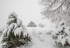 Cabin on a snow covered hill after a snow storm