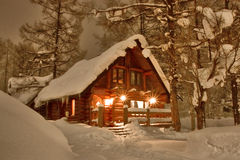 Cabin in the Snow. Log cabin in the snow at night in winter stock image