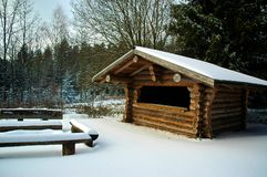 Cabin in Snowy Forest Stock Photography