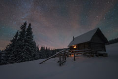 Cabin and stars Stock Photography