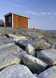 Cabin on a stone beach Royalty Free Stock Image