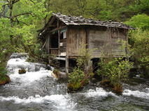 Cabin straddling water Royalty Free Stock Photography