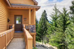 Cabin style home entrance with long walkway and railings. Royalty Free Stock Photo