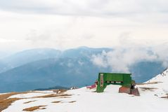 Cabin on top of the mountain in winter.  royalty free stock photography