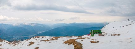 Cabin on top of the mountain in winter panorama royalty free stock images