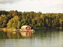 Cabin in the Turku Archipelago, Finland. Cabin and autumn trees on an island in the Turku Archipelago, Finland royalty free stock images
