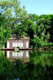 Cabin on waterside and inverted imagine Stock Image