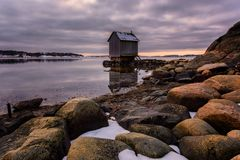 A cabin on the west coast of gothenburg, Sweden. Cloudy days make better pictures Royalty Free Stock Photography