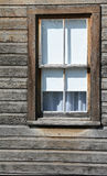 Cabin Window. Window on Side of Weathered Cabin royalty free stock image