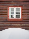 Cabin window behind snowdrift Royalty Free Stock Image