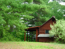 Cabin in the Woods. A log cabin in the woods stock photo