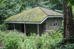 Cabin In Woods. An old, 18th century stone cabin in the woods stock photography