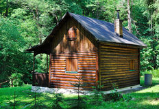 Cabin in the woods. Old wooden cabin in the woods stock images