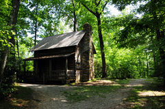 Cabin in the Woods. A log cabin in the woods royalty free stock photo