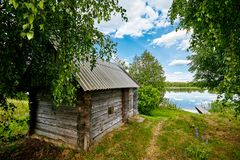 Cabin in the Woods, on the banks of the River. Next to the river stock images