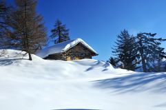 Cabin in the woods covered in snow Royalty Free Stock Photo