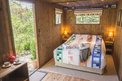 Cabin in the woods with farmers jacket and hat Royalty Free Stock Photography