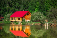 Cabin in the woods. A Cabin in the woods at a lake royalty free stock images