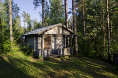 Cabin in the Woods. A log cabin in the woods, Finland royalty free stock images