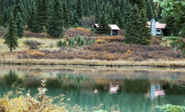 Cabin in the woods reflection Stock Image
