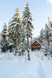 Cabin in Woods Winter with Snow Royalty Free Stock Images