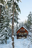 Cabin in Woods Winter with Snow Royalty Free Stock Image