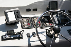 The cabin is a yacht with a steering wheel and other controls. Rudder of the ship in the captain's cabin Royalty Free Stock Photography